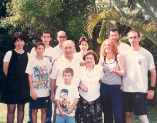 Yisrael Rosenblum (center) and his family, 1997.
