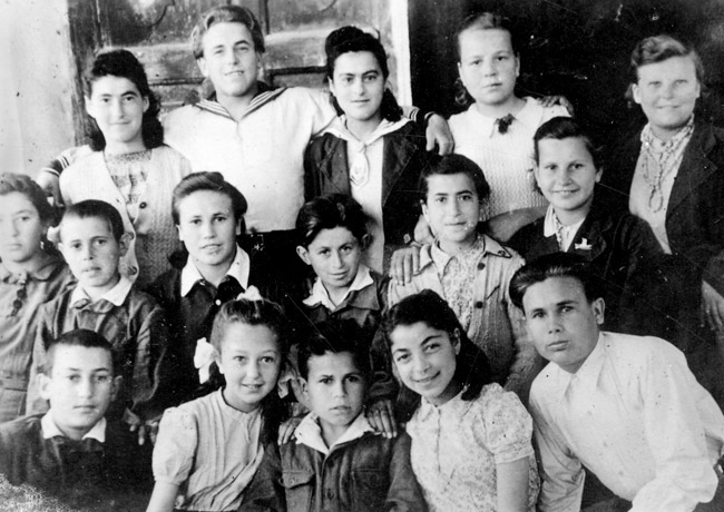 Rachel (third from the left in the top row), Chanka (top row, left), and Zvetla (middle row, second from right) at a children's home after the war.