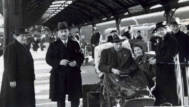 Inge with her father (in wheelchair), mother (right), and other relatives at the train station after Guenther leaves Germany in 1938.
