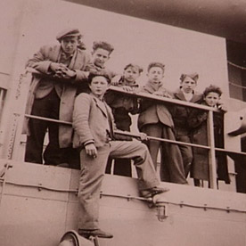 Pawel (in front) aboard a ship bringing refugee children from Germany to the U.S., 1946.