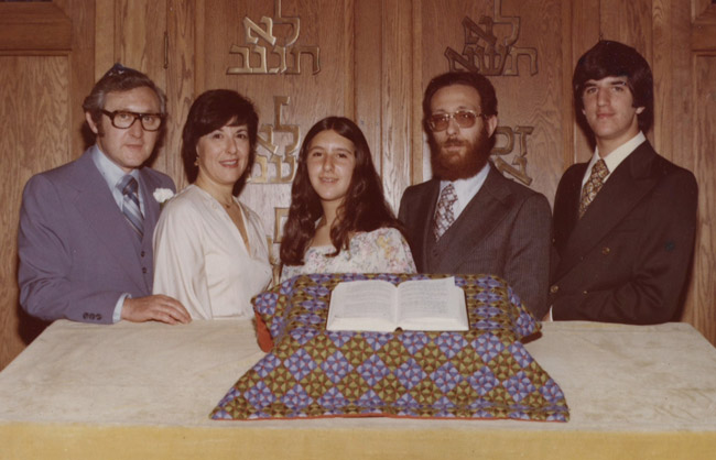 Paul (left), his wife, their children, and their rabbi, at his daughter's bat mitzvah.