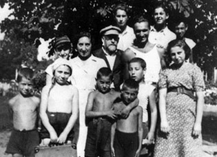 Janusz Korczak and Stefania Wilczynska with children and staff members from their orphanage in Warsaw, late 1930s.