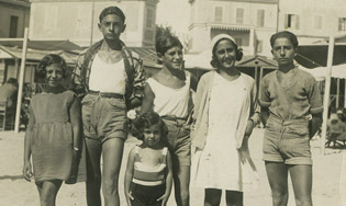 Anna (in front), and her siblings (left to right) Clara, Amedeo, and Enzo at the beach, early 1930s.