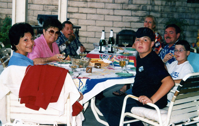 Ann Signett (second from the left) with her husband by her side, her daughter-in-law and son across the table, her niece visiting from Italy in the left-foreground, and her great grandsons in the right-foreground, in 2004.