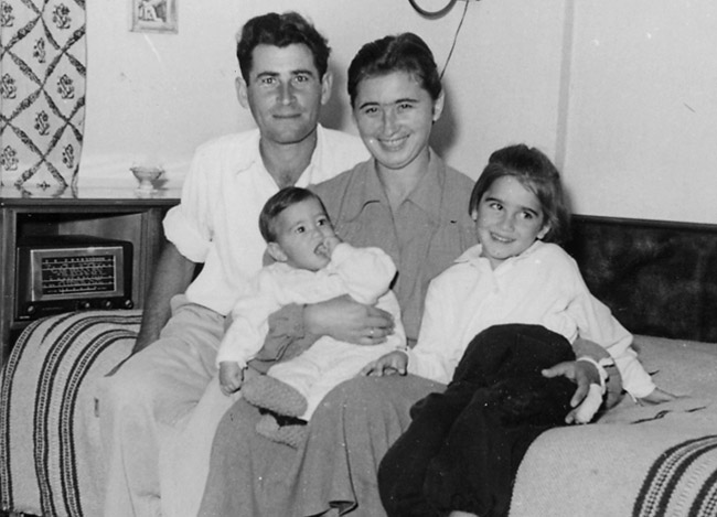Esther and her husband, Avraham, with two of their children.