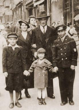 Jakub, Sarah, Maniek, Emilia, and Henryk Wiener on a street in Chorzow, Poland, 1934.
