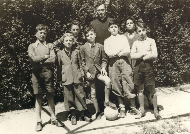 The boys of the Catholic school in Turin, with their teacher. Marek is standing in the back, to the left of teacher, who is a Catholic priest.