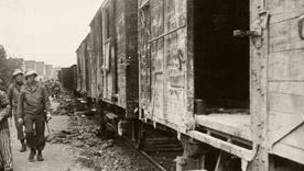 American military police inspecting train cars upon liberation, Dachau, 1945.